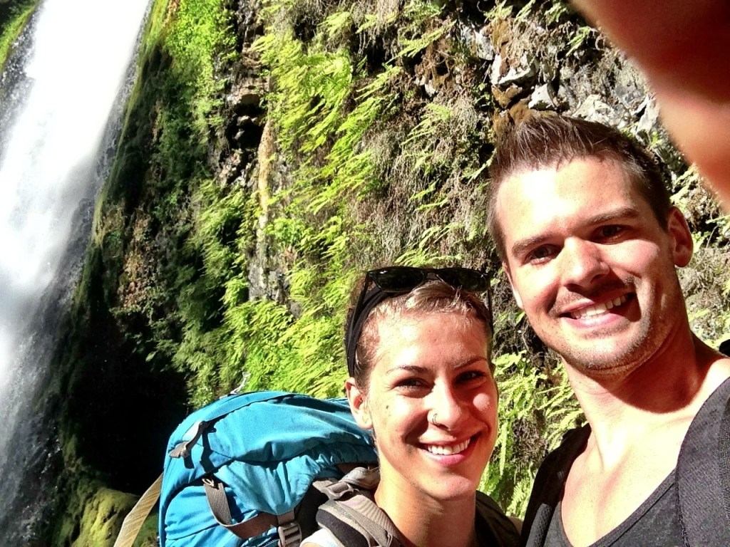 Joe & Emily backpacking through tunnel falls Oregon.