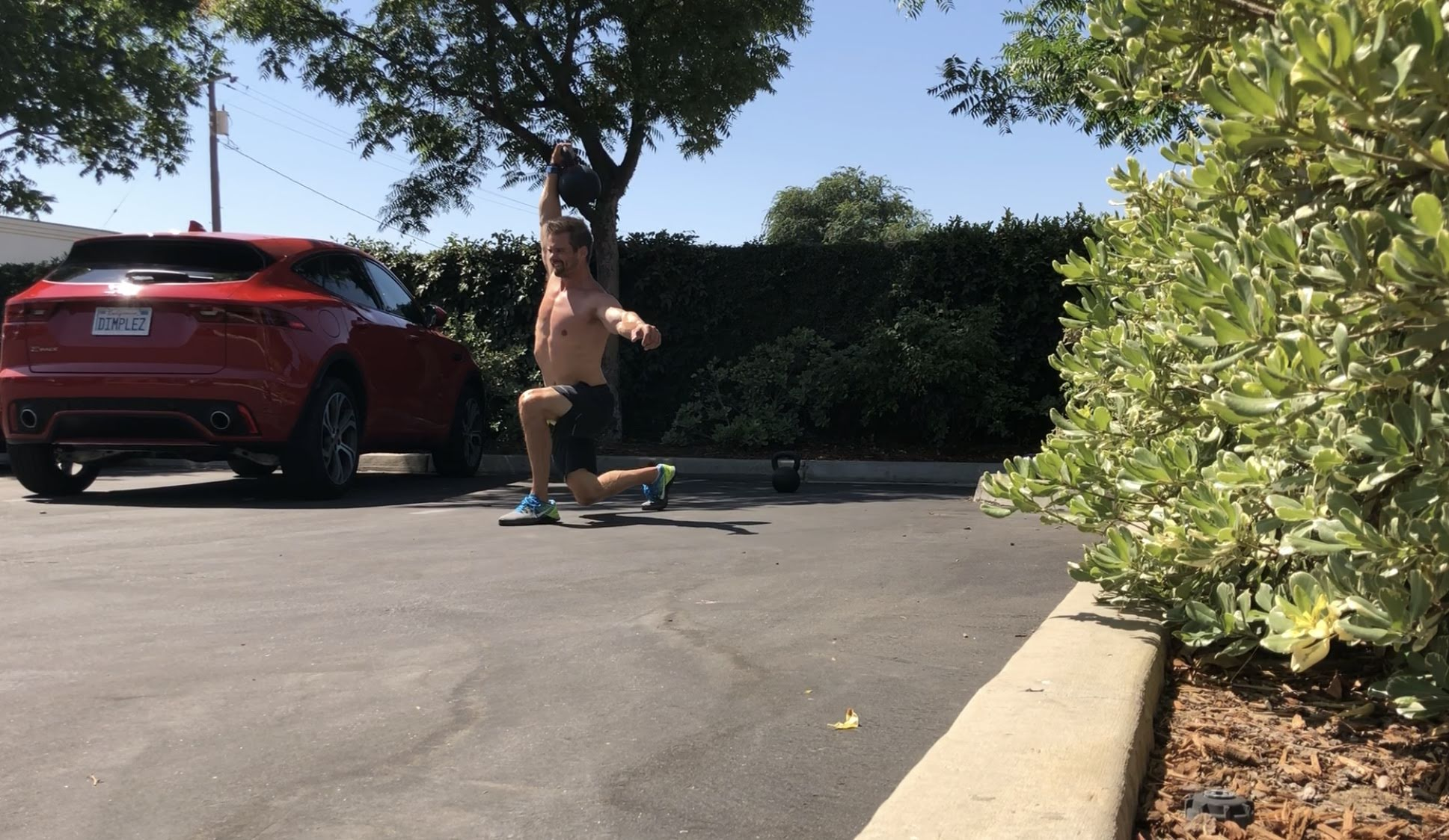 Joe Bauer does Parking lot overhead lunges