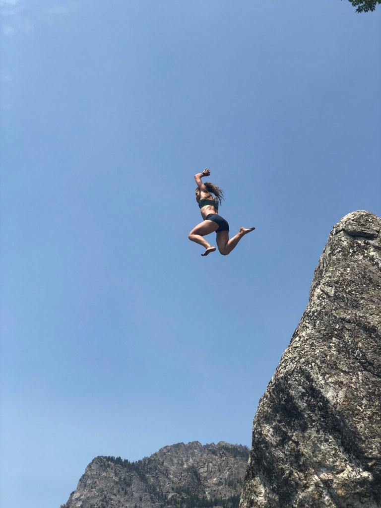 Emily rock jumping at Phelps Lake