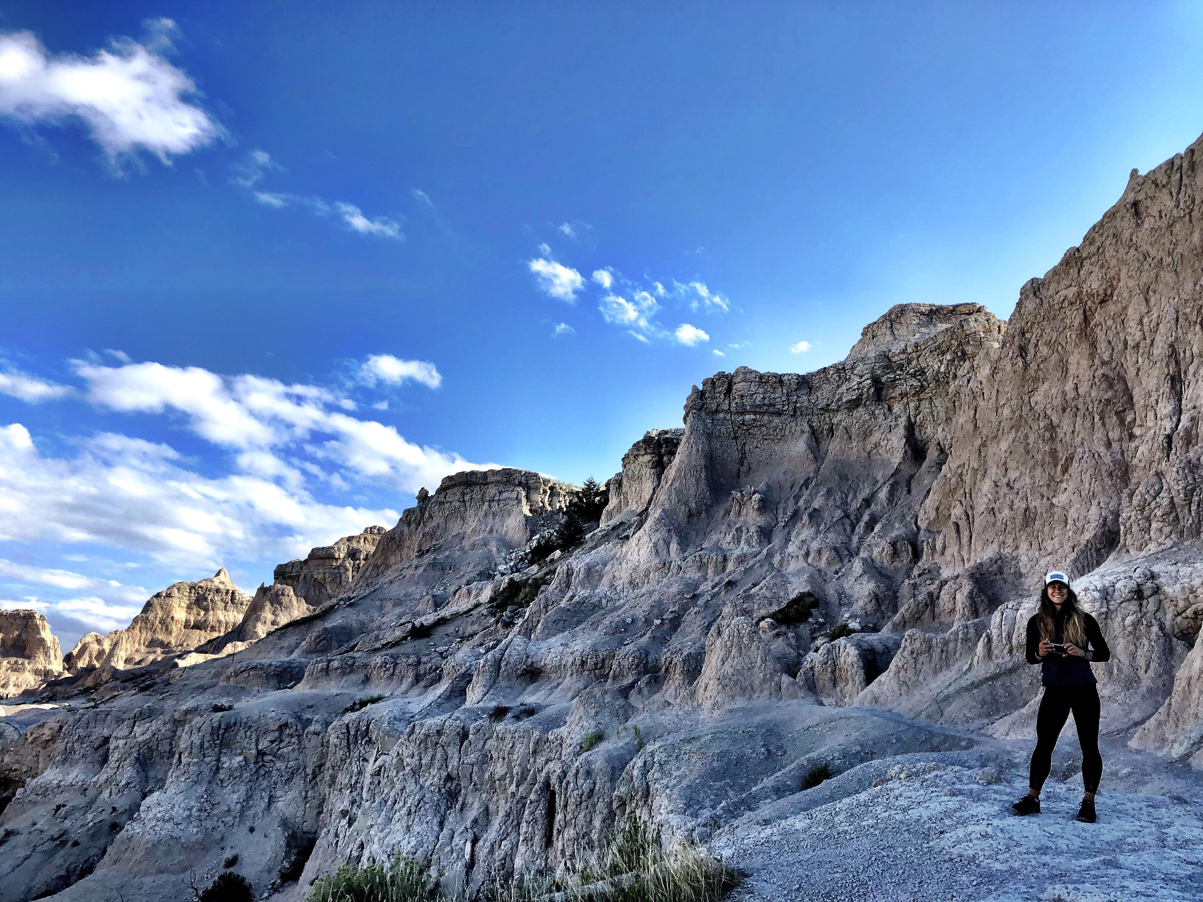 Emily Hiking Badlands National Park van life