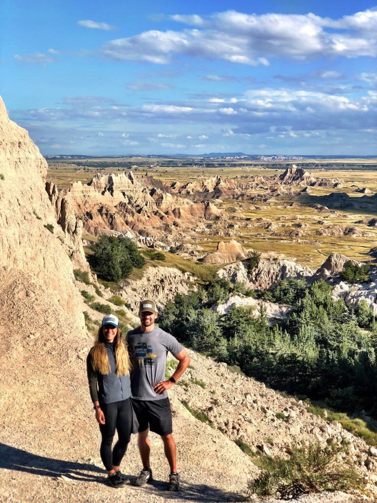 Emily & Joe Hiking Badlands National Park van life