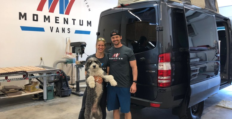 Delivery day at Momentum Vans for Emily, Joe and Pilot