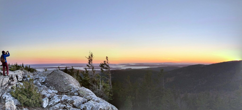 Ali taking picture of sunset in Acadia National Park
