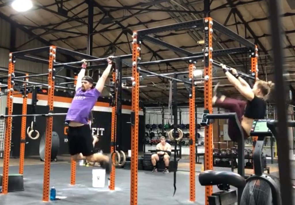 Joe and Emily doing a workout at Rocky Top CrossFit
