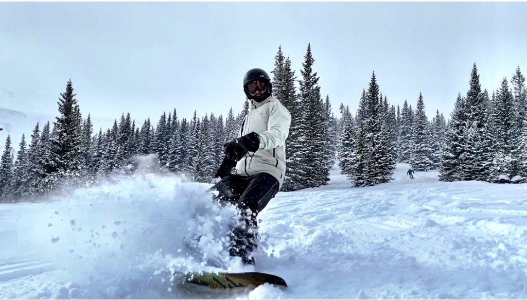 Joe snowboarding a powder day at Snowmass on IKON pass
