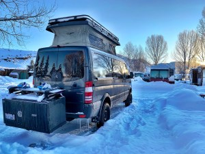 Momentum Vans Sportsmobile Mercedes Sprinter van parked at KOA in Steamboat Springs while riding with the IKON pass