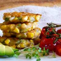 Aussie Breakfast Corn Fritters with Roasted Tomatoes.