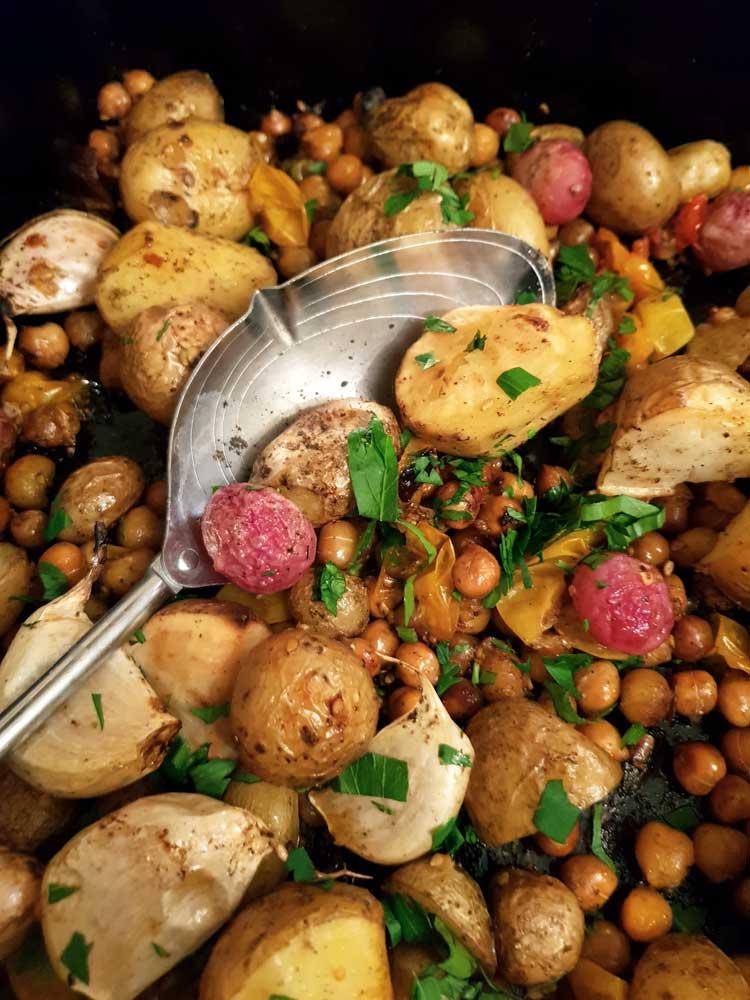 Close Up with spoon of the Potato, Chickpea & Radish traybake