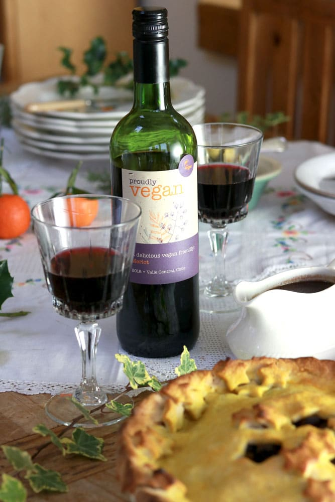 Proudly Vegan Merlot Wine with pie in front of it