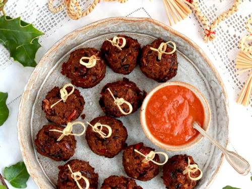 Sweet and Spicy Bean balls with tomato sauce on a platter ready to serve