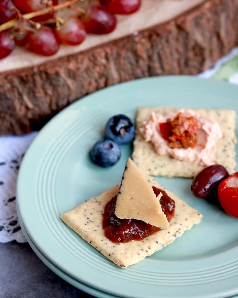 A chunk of vegan cheese on a cracker