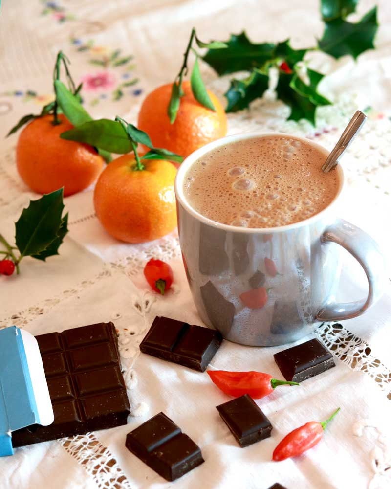 Energising Vegan Spiced Hot Chocolate with satsumas and chocolate squares to nibble on