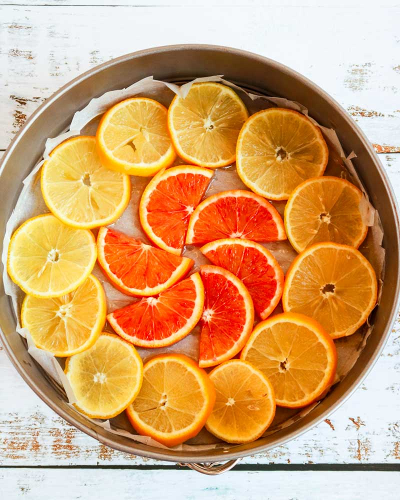Citrus slices in their tin, with carefully cut baking paper to line it