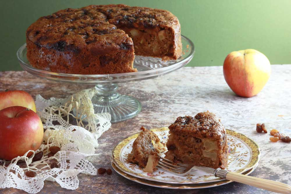 Apple and sultana cake on a plate