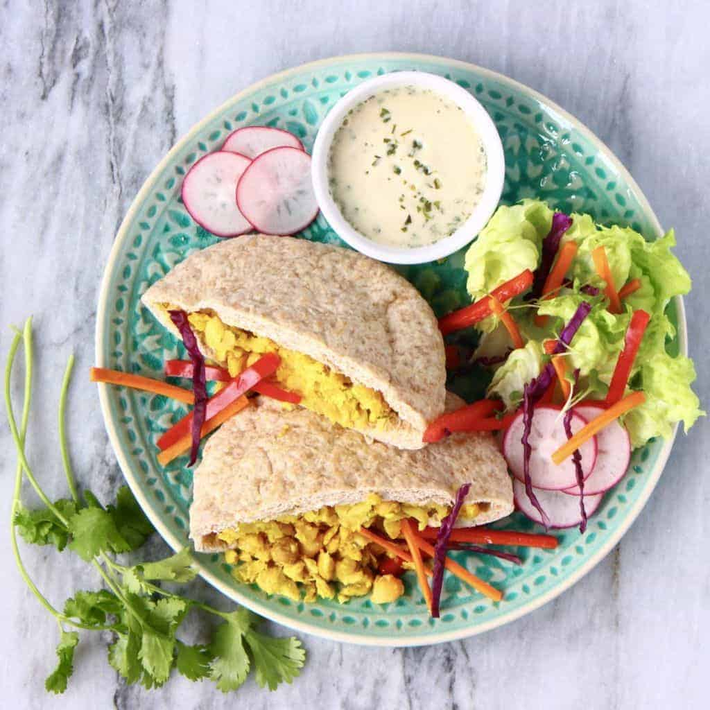 Vegan Falafel sandwich on a plate with salad
