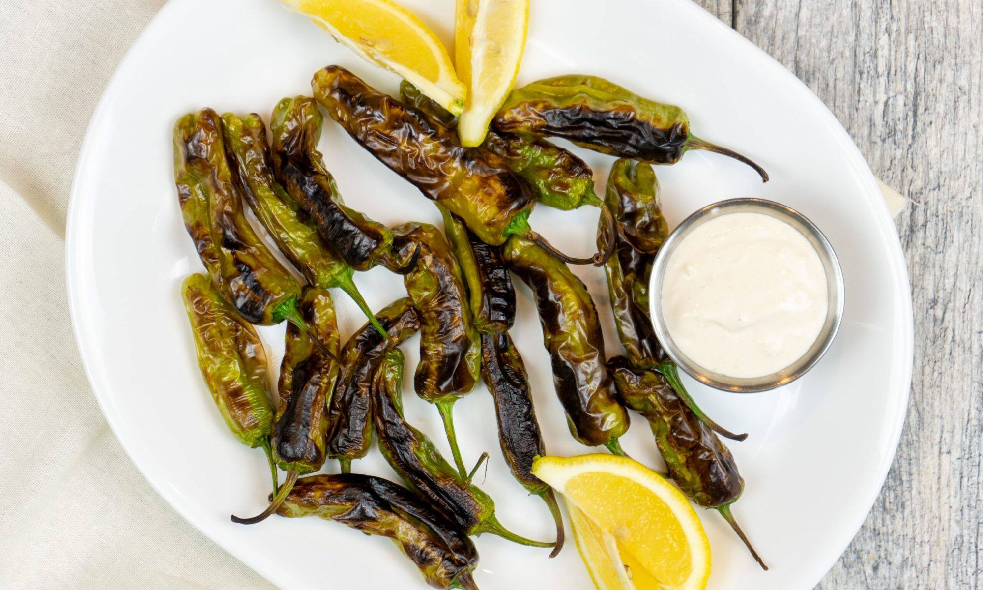 Blistered Shishito Peppers with Garlic Aoli Dipping Sauce - The Vegan Rhino