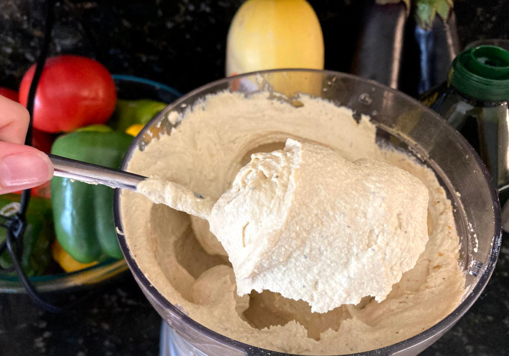 A spoonful of creamy vegan ricotta right out of the food processor.