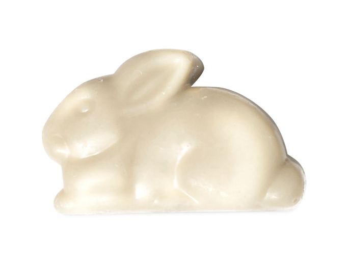 Sjaak's vegan white chocolate bunny laying down with ears back, perfect vegan easter candy.