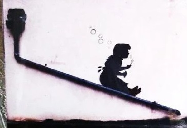 Girl on a Slide, Blowing Bubble art on a Drain Pipe