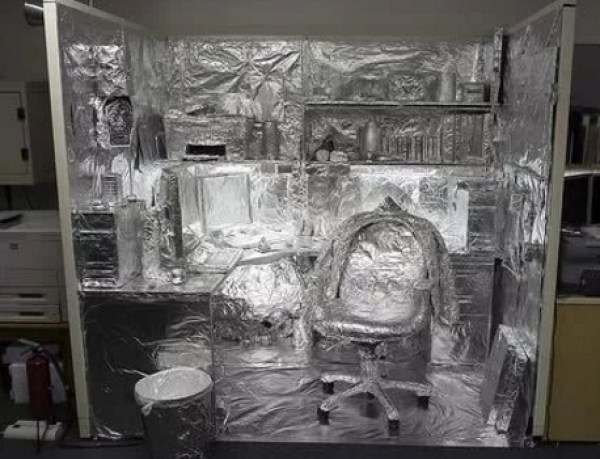 Office covered in tin foil for April fools joke