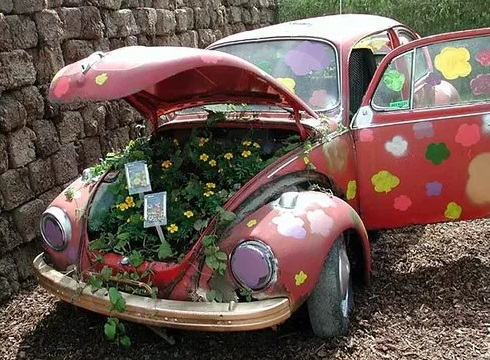 Pink Volkswagen Beetle Covered in Flowers