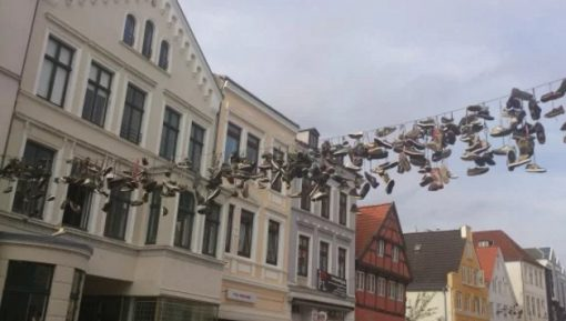 Shoe Tossing: Shoes Hung Over a Telephone Line