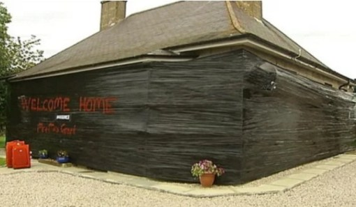 House covered in silage wrap