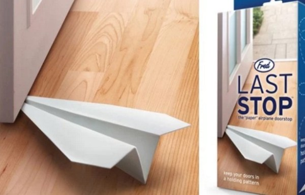 A door stop that looks like a paper plane