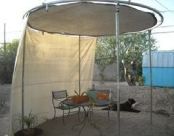 Trampoline Used as a Garden Shade Area
