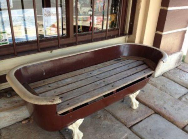 Bathtub repurposed as a bench