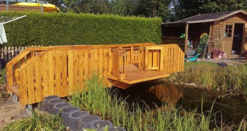 Old Wooden Pallet Transformed Into a Garden Bridge