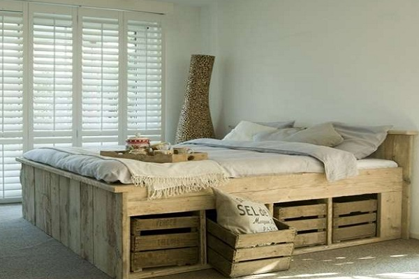 A Bed Made From Pallets and Wine Crates