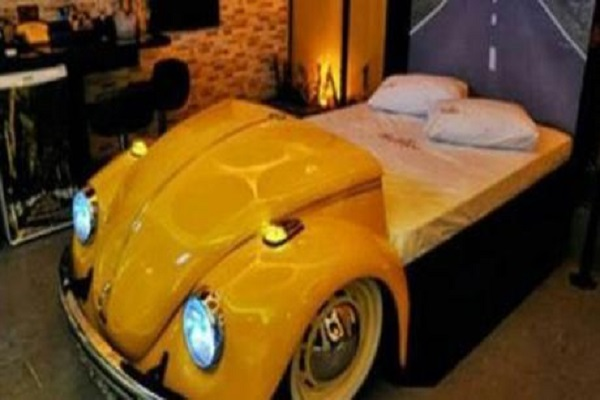 A Bed Made From Old Cars