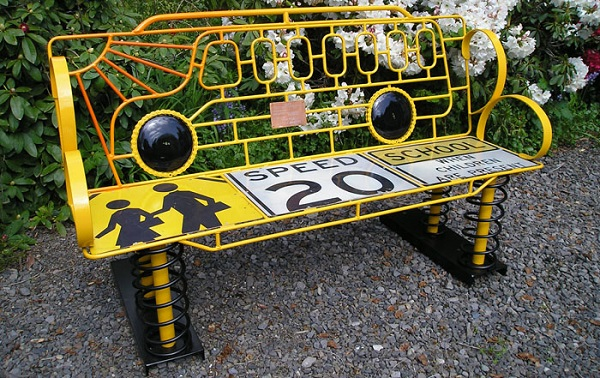 A Garden Bench Made From a Recycled Yellow School Bus
