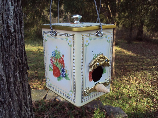 A Birdhouse Made From a Cookie Tin