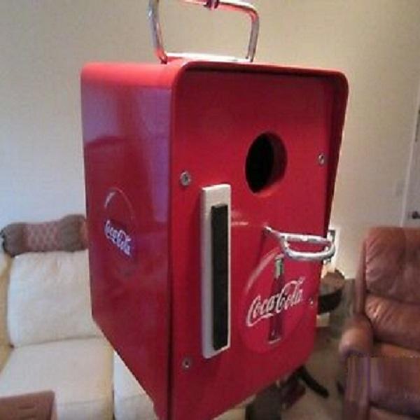 A Birdhouse Made From a Coca-Cola Box