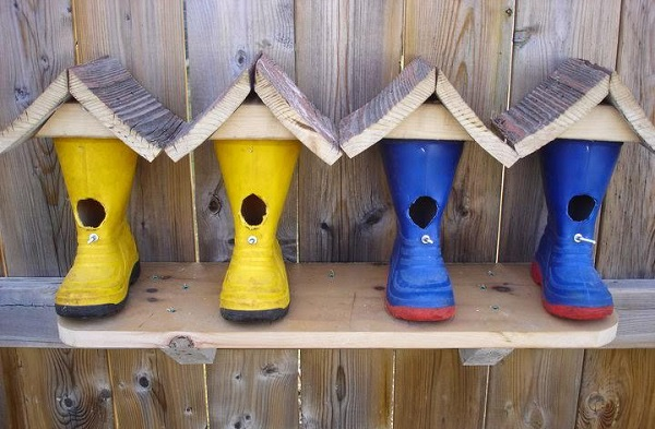 A Birdhouse Made From Rubber Boot
