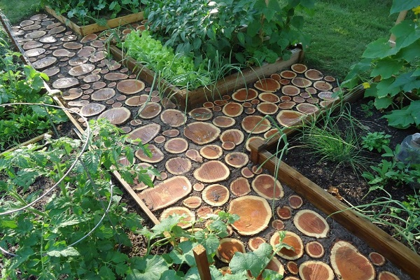 A Garden Path Made With Logs