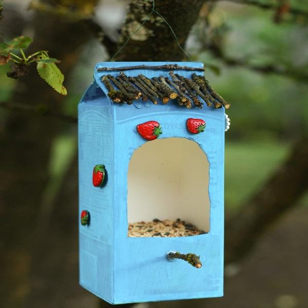 A Bird Feeder Made From a Juice Carton