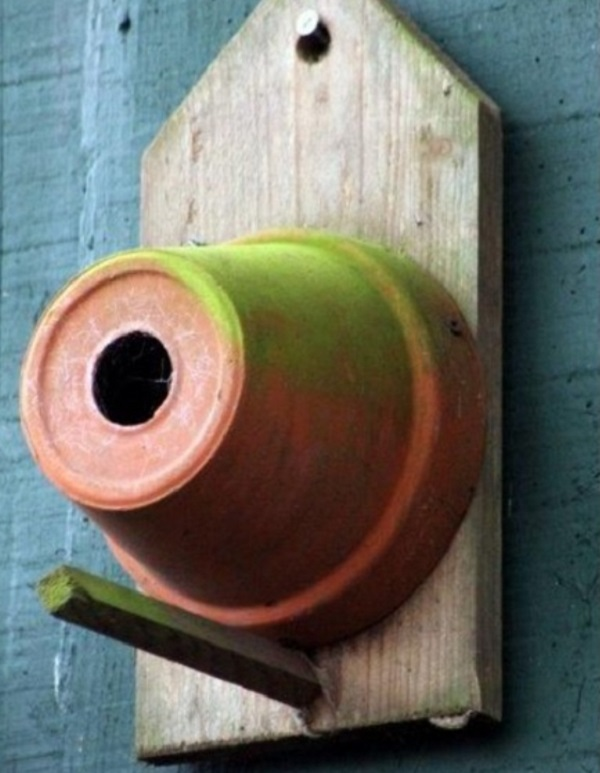 An Old Plant Pot Used to Make a Birdhouse