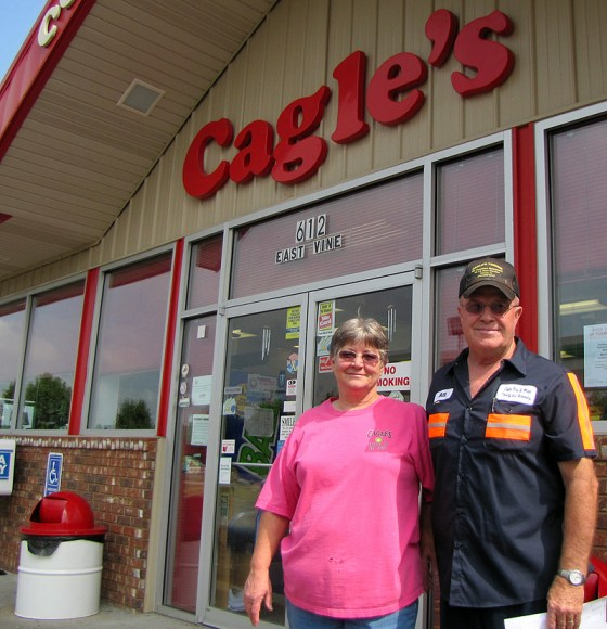 Cagle's owners pose in front of store