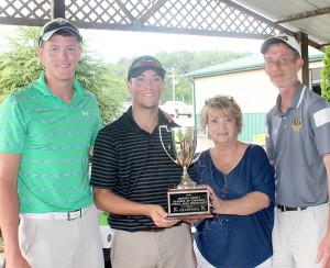 Goreville School took first place at the annual Johnson County Chamber of Commerce golf scramble Friday afternoon. The team shot a 57. Players were, from left, J.T. Russell, Shon Messmer and J.R. Russell. Chamber board member Marsha Hayes presented the first place team with the chamber's travelling trophy at the end of the event.