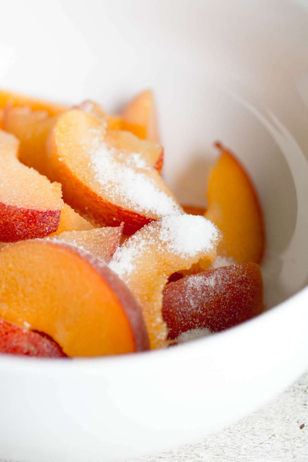 Macerating peaches for Fresh Peach Shortcake