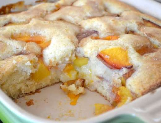 apricot and nectarine cake with slice removed