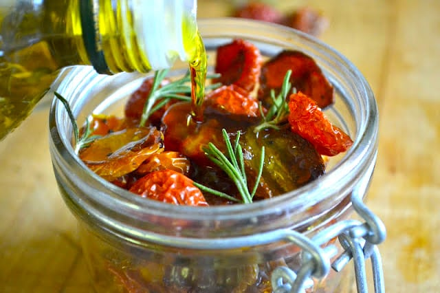 How to Dry Cherry Tomatoes ~ dried cherry tomatoes in a mason jar with olive oil