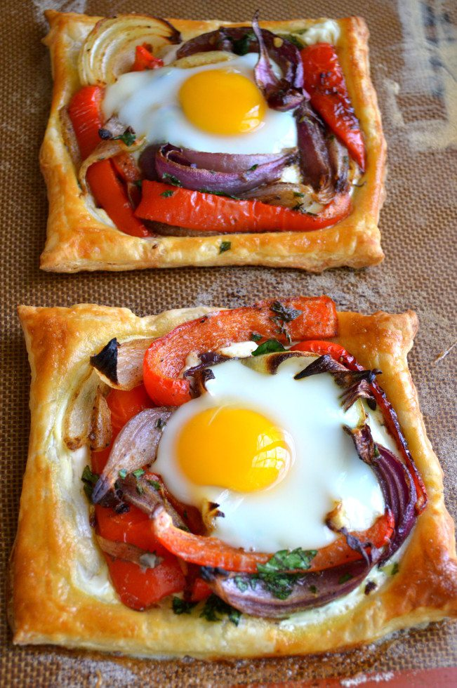 Photo of two red pepper and baked egg galettes on a baking tray.