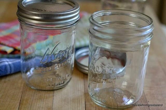 Photo of two empty mason jars for Mason Jar 7 Bean Salad .