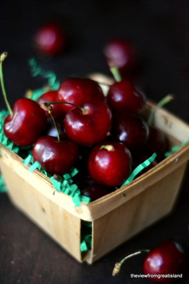 Fresh cherries in a basket for Spiced Cocktail Cherries