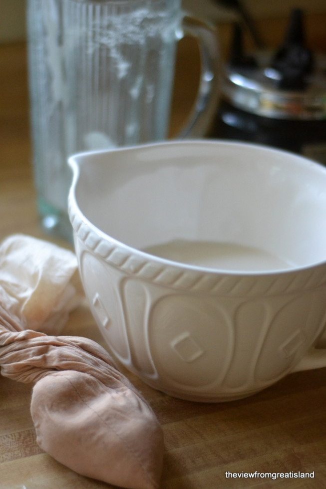 Photo of mixing bowl with homemade almond milk.