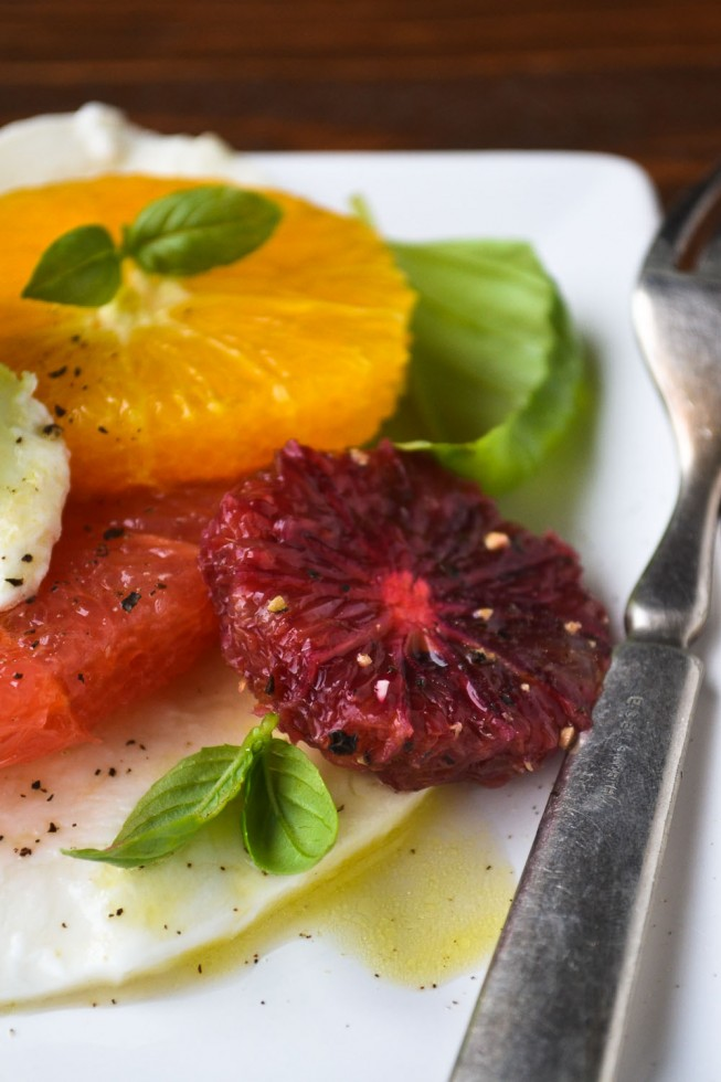 Juicy citrus stand in for tomatoes in this twist on a classic caprese salad!